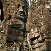 "Angkor Wat : The area around Angkor Wat near the city of Siem Reap, Cambodia, is truly one of the amazing wonders of the world.  The dramatic vastness and richness of these ruins illustrate what a magnificent place this must have been in it's prime.  I wonder about the amazement of seeing these ruins for the first time buried in the jungle as dreamed about when watching Indiana Jones movies of years ago.   There are several sections to this area typically classified as ""Angkor Wat"".  Angkro Wat itself is a large, moated set of temples and ruins that is illustrated in the first few images.  Also included further around this area is the Angkor Thom complex, mostly noted for the amazing large sculptured faces of Bayon.   Nearby is the ""Laura Croft"" area of Ta Prohm, where the large native trees engulf the ruins in dramatic fashion.  Finally, further out away from Siem Reap are the two newer sites, including Banteay Srei and its finely ornamented carvings dedicated to women and the still jungle-covered area of Beng Mealea."